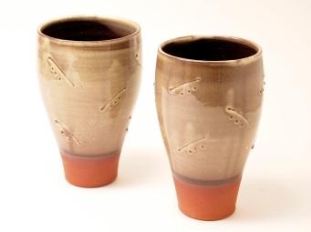 Slipware beakers with slip trailed decoration