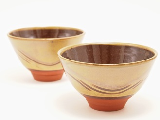 Copper green slipware bowls with combed decoration